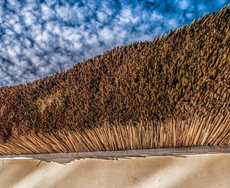 White Wall, Thatch and Cirrus Clouds